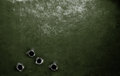 Metal green military armor background with bullet holes Royalty Free Stock Photo