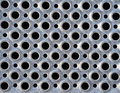Metal grid pattern background of circular holes on a step Royalty Free Stock Photo