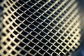 Metal grid texture with small wholes and pattern shapes Stock Photos
