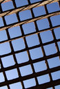 Metal grille on blue sky background Royalty Free Stock Photos
