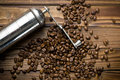 Metal grinder with coffee beans top view of Stock Images