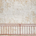 Metal grunge railings near the wall Royalty Free Stock Photo