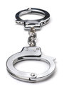Metal handcuffs on a white background Royalty Free Stock Photo