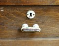 Metal handle and keyhole of an old wooden table close up Royalty Free Stock Image