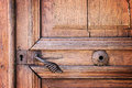 Metal handle and lock on an old wooden door Royalty Free Stock Photo
