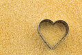 Metal heart shaped cookie cutter on unrefined unbleached Crystal Royalty Free Stock Photo