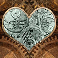 Metal heart ticking inside grungy background in the style of steam punk Royalty Free Stock Photos