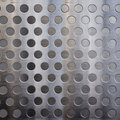 Metal with holes Royalty Free Stock Images