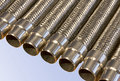 Metal hoses with fittings closeup Royalty Free Stock Photography