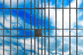 Metal jail bars on a sky background Stock Images