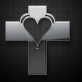 Metal jesus cross heart shape on grey background Royalty Free Stock Photography