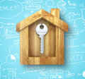 Metal key hanging in a wooden house Stock Photo