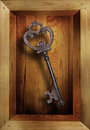 Metal key in wooden box Royalty Free Stock Photo