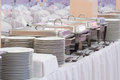 Metal kitchen equipments on the table for fine wedding dining or another catered event and empty plates Stock Photo