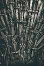 Metal knight swords background. Close up. Royalty Free Stock Photo