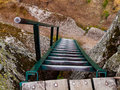 Metal ladder on the rock viewpoint viwe from above Royalty Free Stock Images