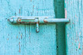 Metal latch on an old blue door close up Royalty Free Stock Image