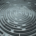 Metal maze a circular on a white floor Stock Photos