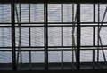 Metal mesh framework against the gray sky background Royalty Free Stock Photos