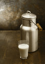Metal milk can with glass of fresh milk Royalty Free Stock Photo