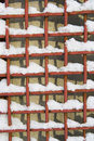 Metal net with snow Royalty Free Stock Photo