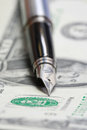 Metal nib pen on dollar bill close up Stock Photo