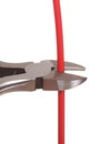 Metal nippers is cutting cable Royalty Free Stock Photo