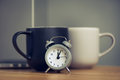 metal old alarm clock with coffee cup Royalty Free Stock Photo