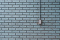Metal Outlet on Aqua Painted Bricks Royalty Free Stock Photo