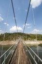 Metal pedestrian suspension bridge Royalty Free Stock Photo