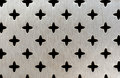 Metal perforation of a cross pattern texture Royalty Free Stock Photo