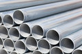 Metal pipes close up stack of construction Royalty Free Stock Images