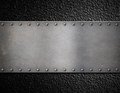 Metal plate with rivets background Royalty Free Stock Photo