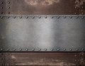 Metal plate with rivets over rustic steel Royalty Free Stock Photo