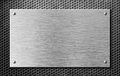 Metal plate or signboard with rivets over grid Royalty Free Stock Photo