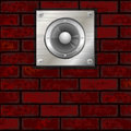 Metal plate with speaker over red brick wall Royalty Free Stock Photography