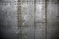 Metal plates assembled with rivets photo closeup old rusty grunge steel aluminum fragment of protective structure made of sheets Stock Images