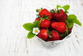 Metal pot with strawberries Royalty Free Stock Photo