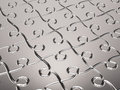 Metal puzzle background Stock Photography