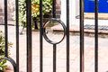 Metal railings an image of outside looking through to a blue door complete with step Royalty Free Stock Images