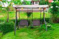 Metal rattan swing in garden Royalty Free Stock Photography