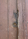 Metal ring on an old wooden door Royalty Free Stock Photo