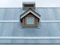 Metal roof small dormer window architecture detail architectural of in sheet of residential house Royalty Free Stock Photography