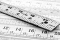 Metal ruler a closeup of a used on a background of measurements Royalty Free Stock Photo