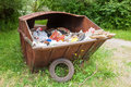 Metal rusty dumpster full of garbage near the wood in the savica nature park on the outskirts zagreb croatia Royalty Free Stock Photos
