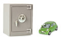 Metal safe on a white background with green car Stock Photos