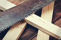Metal saws and sawn timber on the table. Focus on the teeth of t Royalty Free Stock Photography