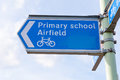 Metal sign post for Primary School, Airfield and cycle path Royalty Free Stock Photo