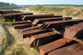 Metal sleepers on sand mine field for quick remount Stock Photography