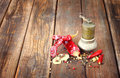 Metal spice grinder with red hot peppers and bay leaf Royalty Free Stock Photo